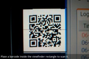Barcode Scanner Focusing on QR Code on Monitor