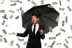 Business man looking satisfied raining money
